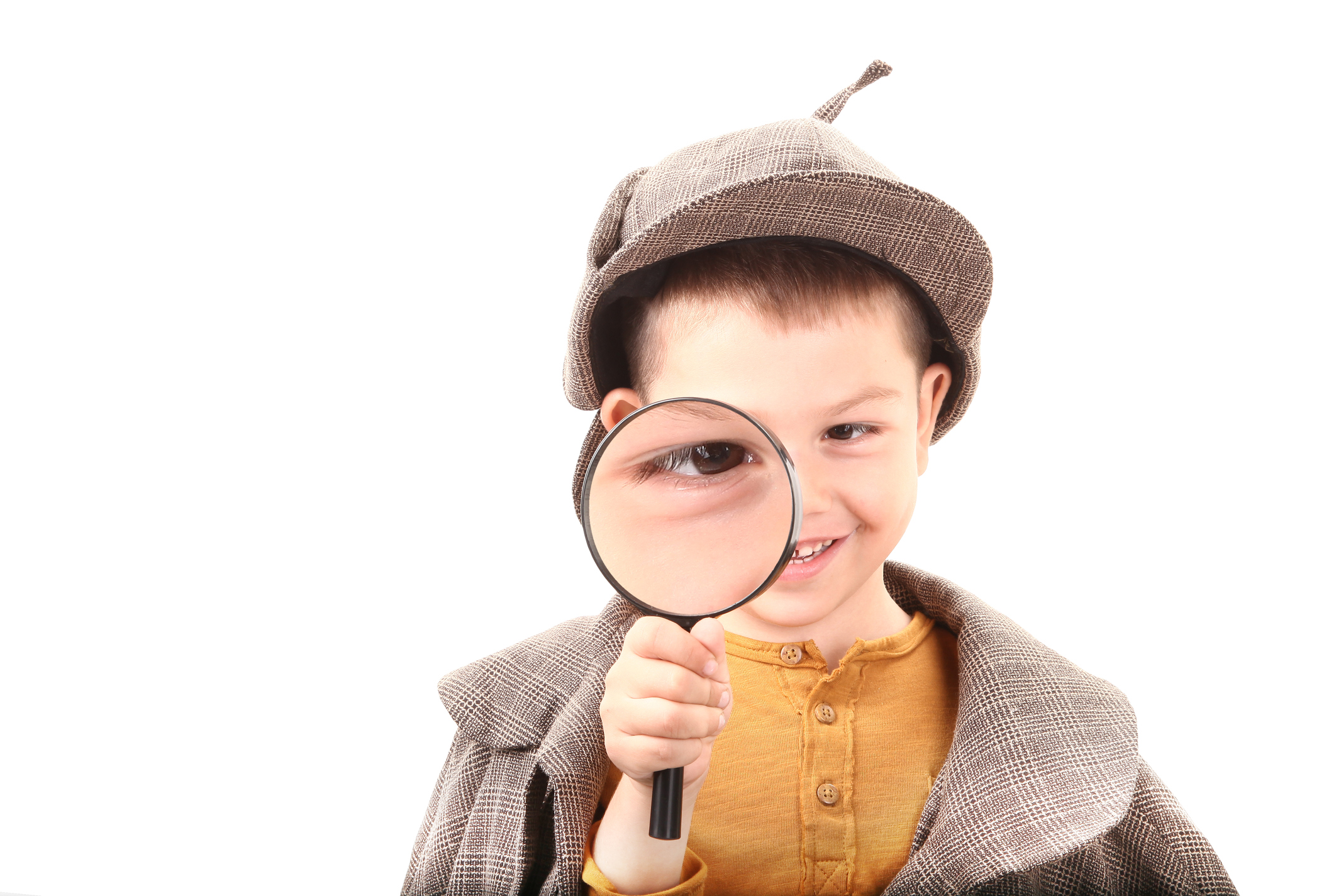 This detective boy is looking through magnifying glass.